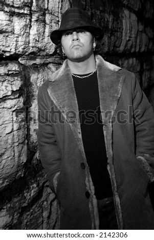 Man in alley looking up - stock photo
