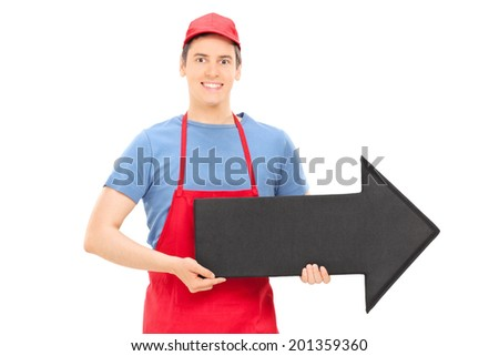 Man in apron holding a big black arrow pointing right isolated on white background - stock photo
