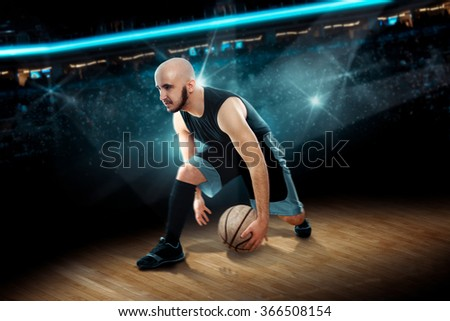 man in basketball action game dribbles. . Basketball game. Sportsman plays basketball. - stock photo