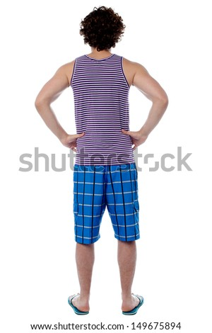 Man in beach wear facing the wall - stock photo