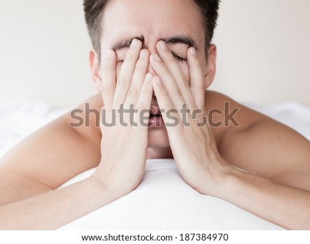 Man in bed suffering insomnia and sleep disorder. Lack of sleep. - stock photo