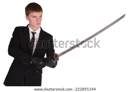 man in black costume and katana sword isolated on white - stock photo