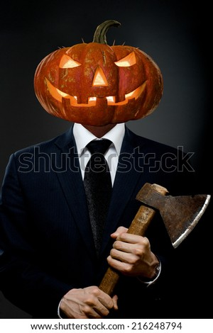 Man in black costume with pumpkin head  with axe, Halloween concept