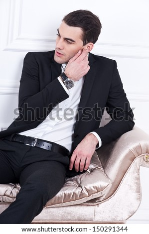 Man in black dinner jacket with bow tie. Bridegroom - stock photo