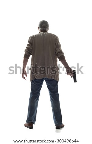 Man in black glove with a gun Back view of man in black glove with a gun in hand isolated on white background - stock photo