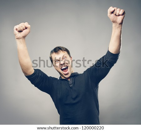 Man in black jacket rejoicing - stock photo