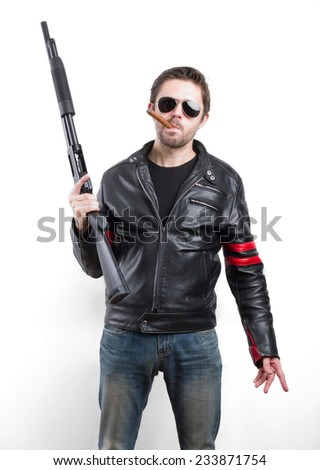 Man in black leather jacket and sunglasses with gun - stock photo