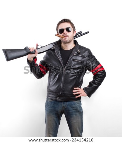 Man in black leather jacket, sunglasses and cigar with gun - stock photo