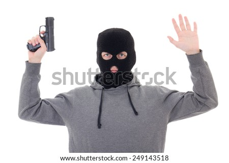 man in black mask with gun holding hands up isolated on white background