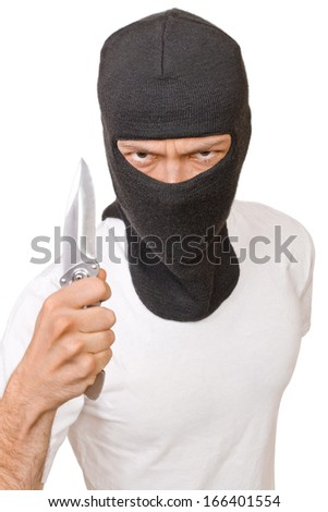 Man in black mask with knife isolated on white background - stock photo