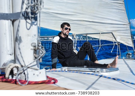 man in black on the yacht relax