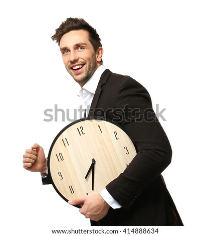 Man in black suit holding big clock is late for work on white background - stock photo