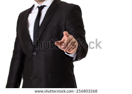 Man in black suit pushing blank virtual button on touch screen. - stock photo