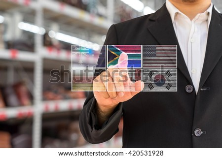 man in black suit select country for business plan on white background for use to create photo concept