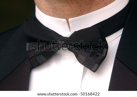Man in black suit with bow tie