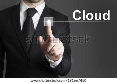 man in black suite pressing virutal button cloud - stock photo