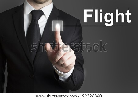 man in black suite pressing virutal button flight - stock photo