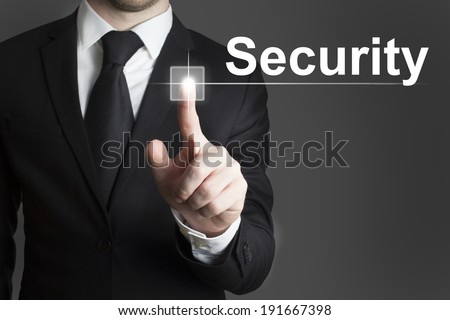 man in black suite pressing virutal button security - stock photo