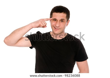 man in black T-shirt shows gesture crazy isolated on white background - stock photo