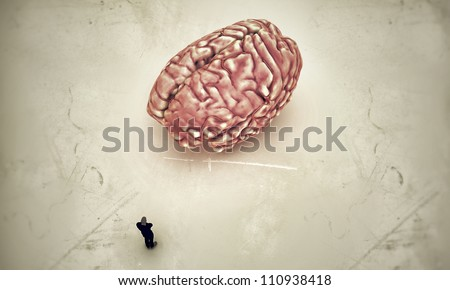 man in black thinking with a big brain