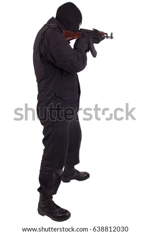 Man In Black Uniform And Mask With AK 47 Gun