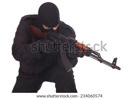 man in black uniform with machine gun isolated on white - stock photo