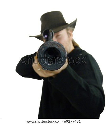 Man in black with black hat pointing a rifle with a view down the barrel of the gun, isolated on white with clipping path