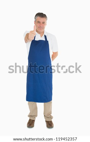 Man in blue apron giving thumbs up