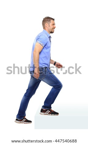 Man in blue shirt  following up  over the white background