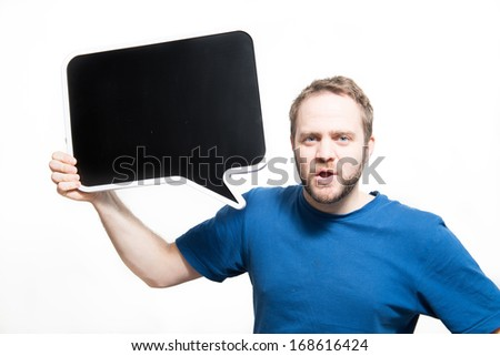 Man in blue shirt holds up empty chalk board conversation bubble - stock photo