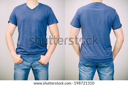 Man in blue t-shirt. Grey background. - stock photo