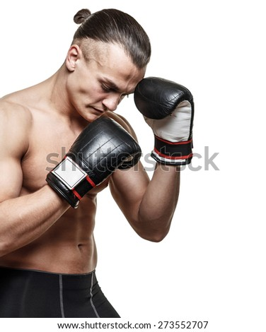 Man in boxing gloves posing on white background