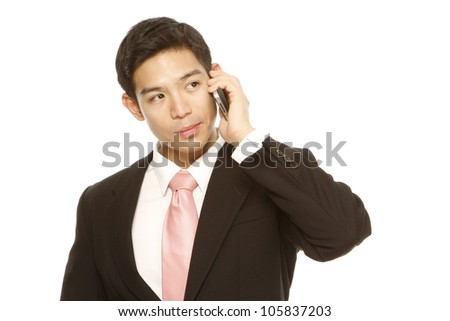 Man in business attire using a mobile phone (on white)