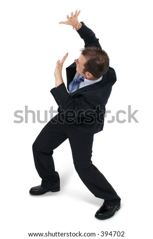 Man in business suit cowering facing away. - stock photo