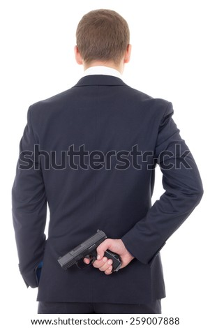 man in business suit hiding gun behind his back isolated on white background - stock photo