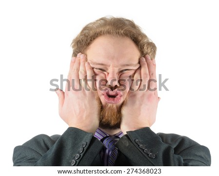 man in business suit makes faces