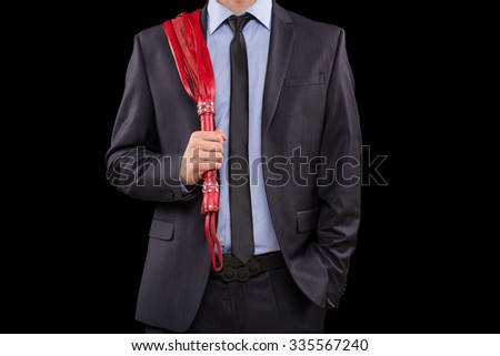 man in business suit with chained hands. handcuffs for sex games - stock photo