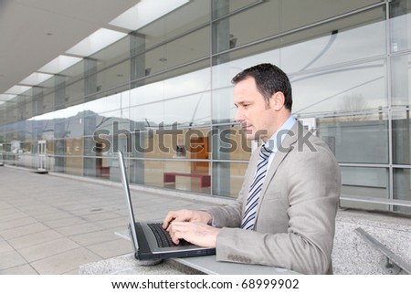 Man in business travel working on laptop computer