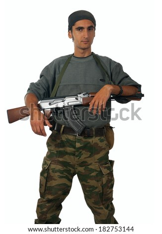Man in camouflage with gun. Isolated on white background.