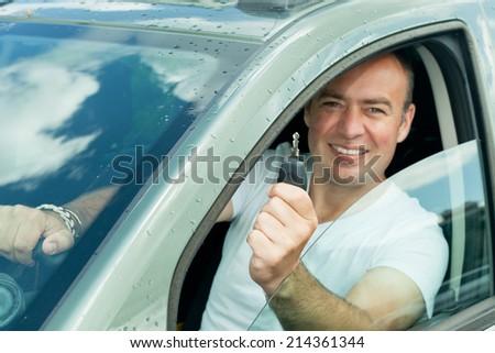 man in car - stock photo
