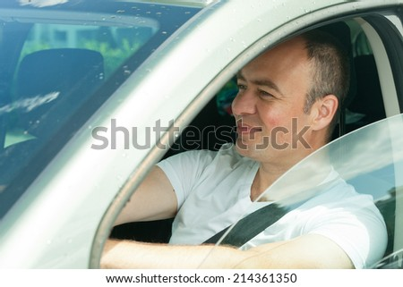 man in car - stock photo