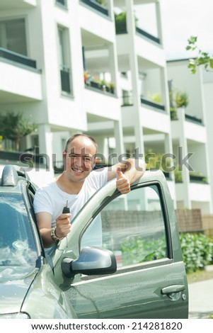 man in car with key - stock photo