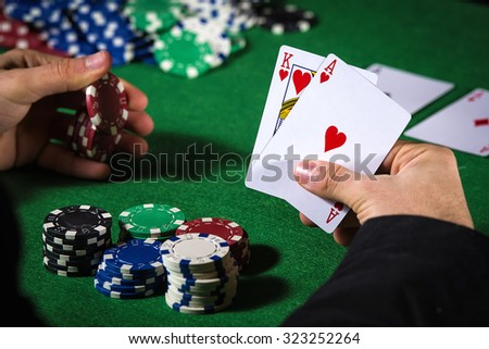 Man in casino with couple of ace and king - stock photo