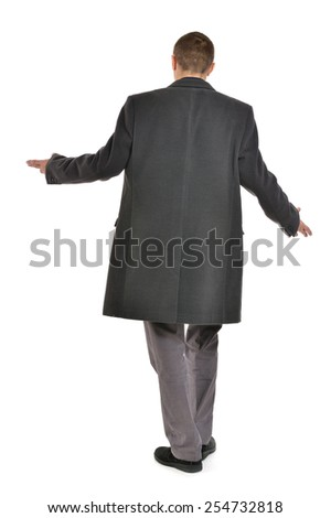 Man in coat threw up his hands ,full length ,back view on a white background - stock photo