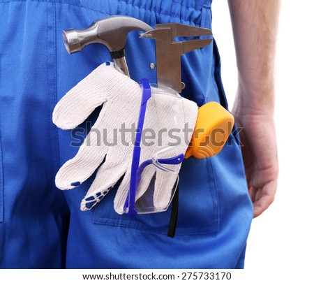 Man in coveralls with tools in his pocket isolated on white - stock photo