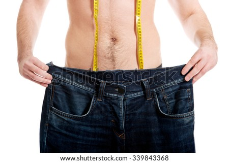 Man in dieting concept with oversized jeans. - stock photo