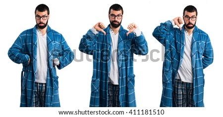 Man in dressing gown doing bad signal