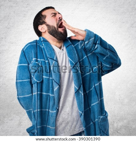 Man in dressing gown yawning