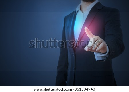 man in formal wear touching empty virtual glass over dark blue background - stock photo