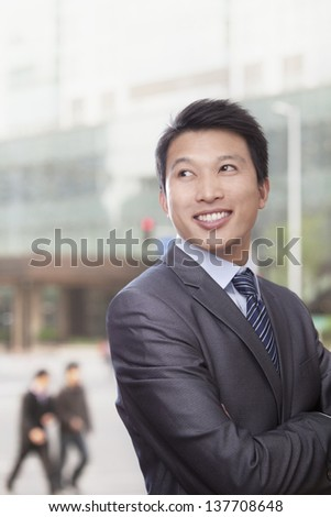 Man in front of Building - stock photo